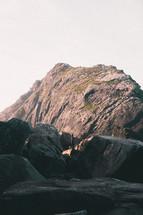 sunlight on rocks against the sky