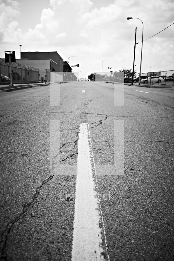 The white stripe in the middle of the road