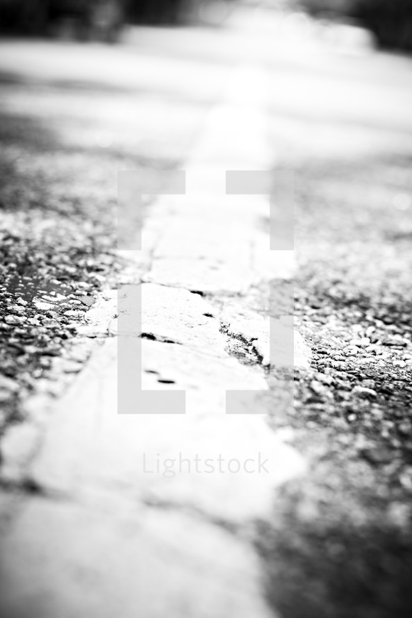 A white stripe in the middle of the road