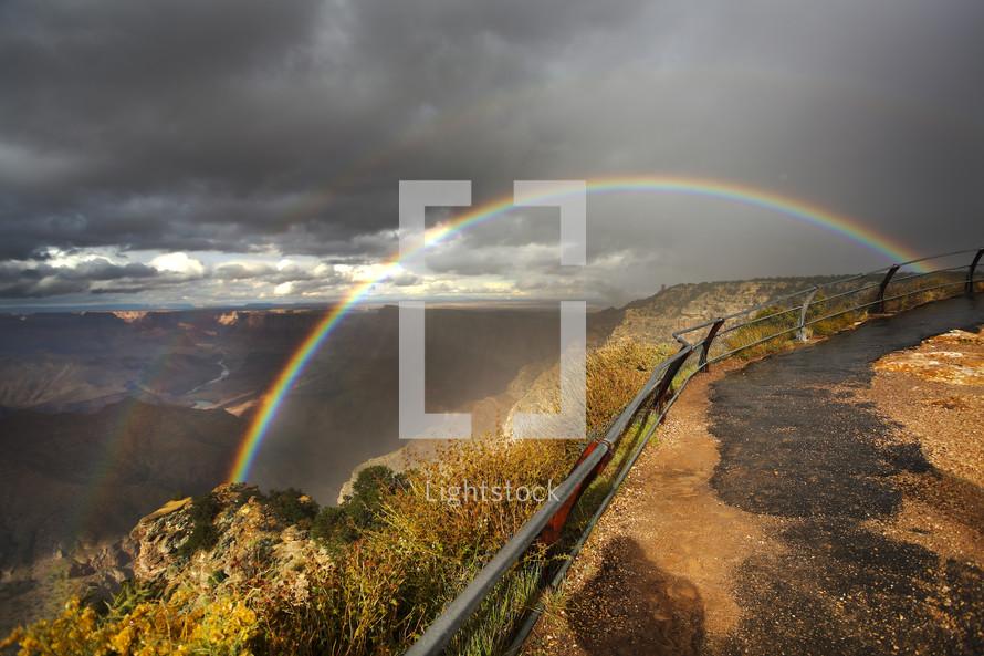 Rainbow along a canyon ridge.