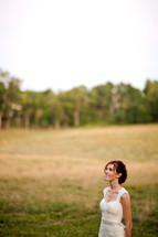 Bride in open grass field
