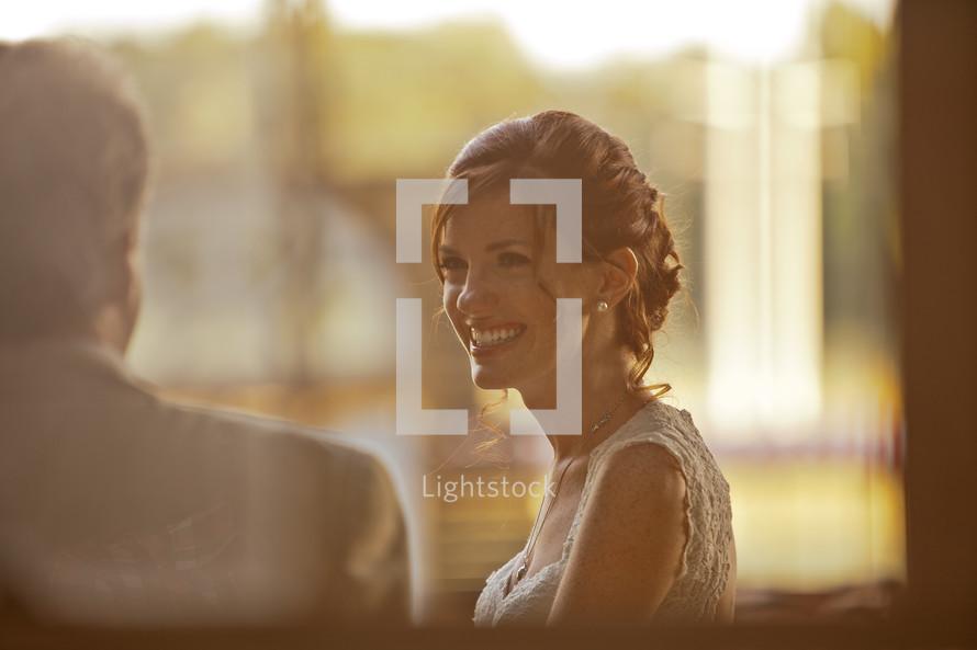 profile of a smiling bride