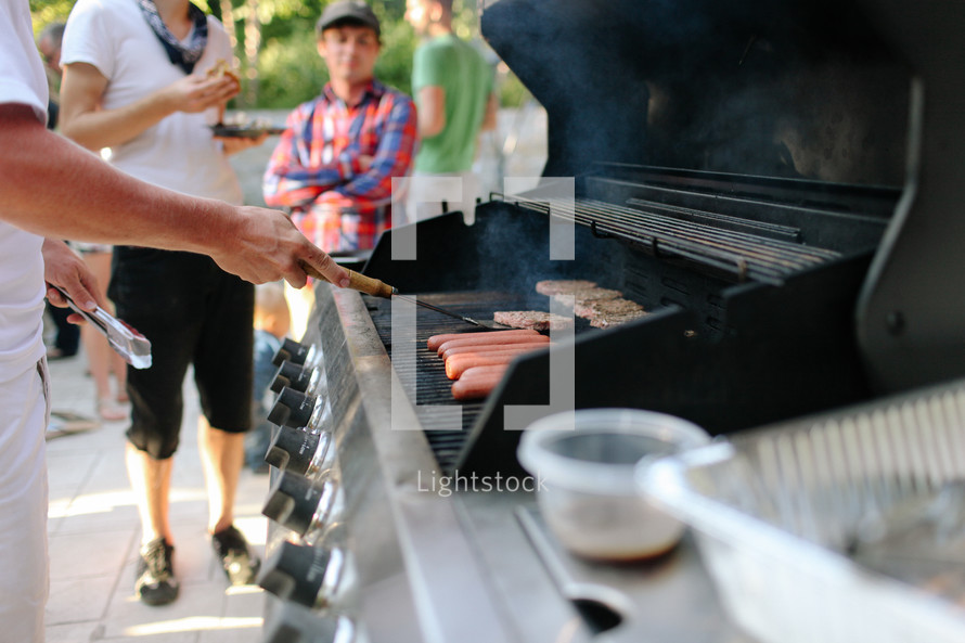 Man grilling barbecue
