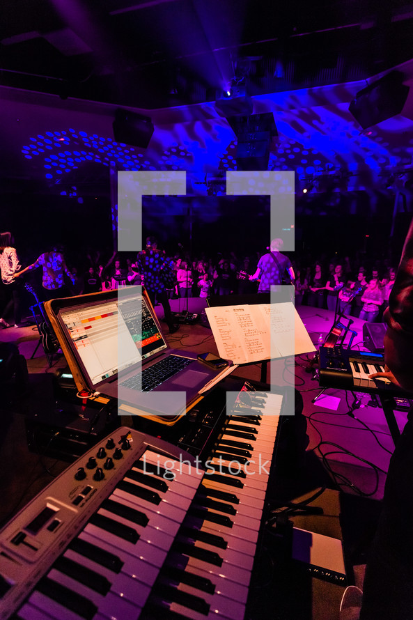 Worship service keyboard on stage team band synthesizer midi Mac computer