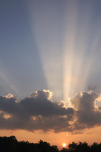 rays of sunlight through the clouds at sunset