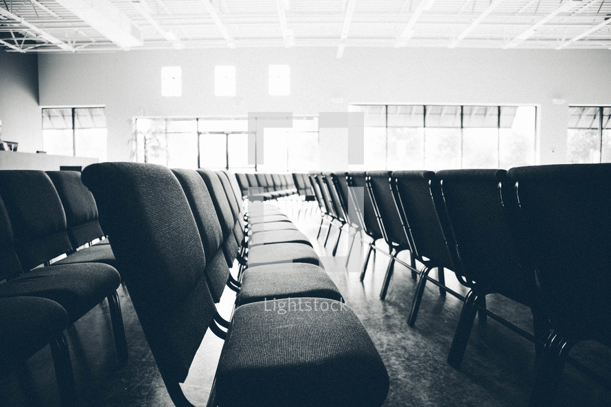 rows of empty chairs in a church