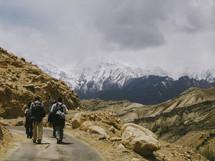 Friends on mountain hike path