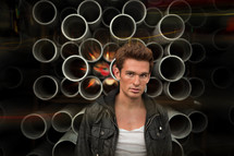 man standing in front of pipes