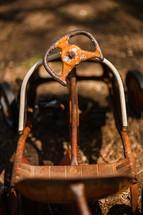 steering wheel on an antique steel metal toy car, childhood vintage, classic
