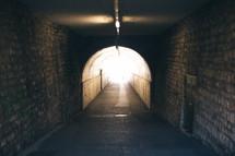 ceiling lights in a dark tunnel