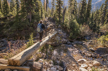 crossing a wooden beam over a stream