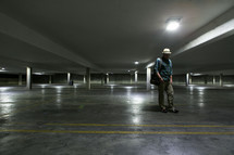 Man in empty parking garage