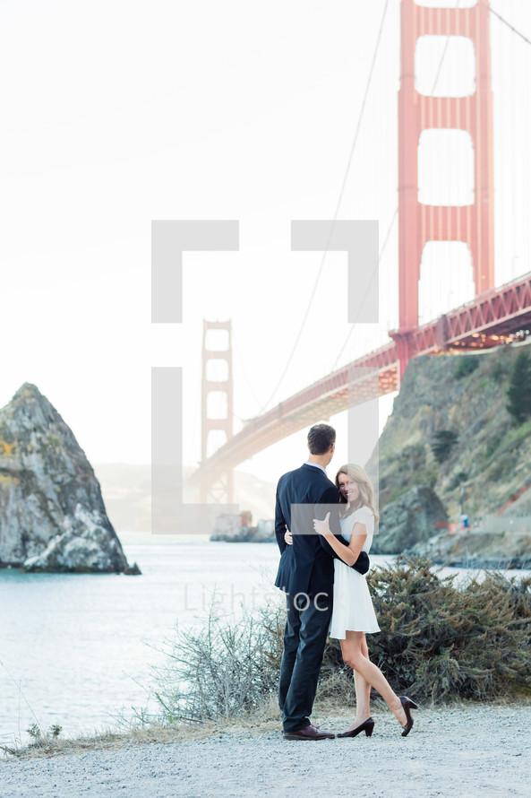 Couple by Golden Gate Bridge