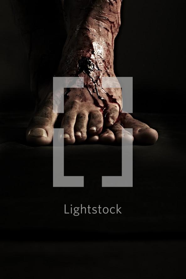 Blood flows down Jesus' nail scarred feet