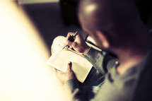 A young man writes in his journal