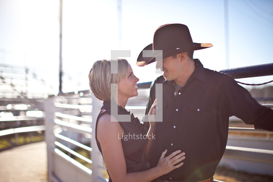 Couple in cowboy hat looking into each other's eyes
