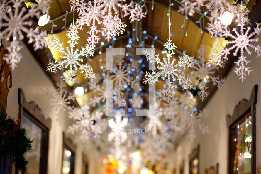 Snowflakes hanging from a ceiling