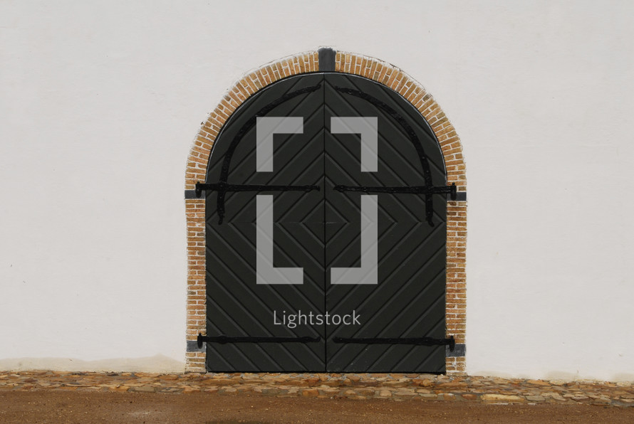 closed doors in an arched doorway