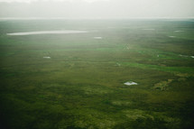 aerial view above the green landscape of Alaska
