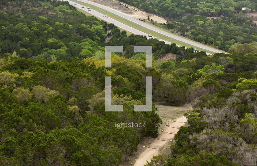 Treetops overlooking the highway.