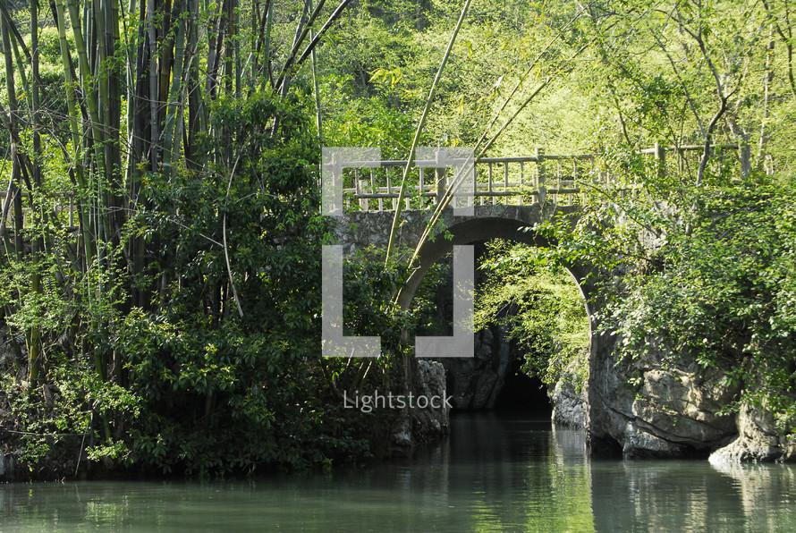 Oriental ornamental bridge over still water
