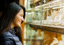 woman looking at jewelry