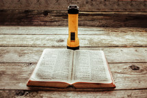 flashlight and open Bible