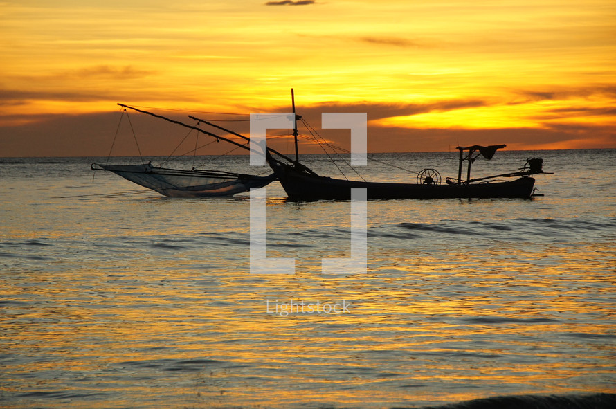 A fishing boat at sunset