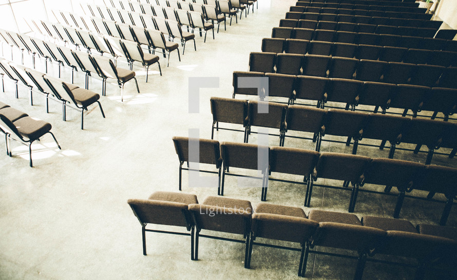 church nave between empty rows of chairs