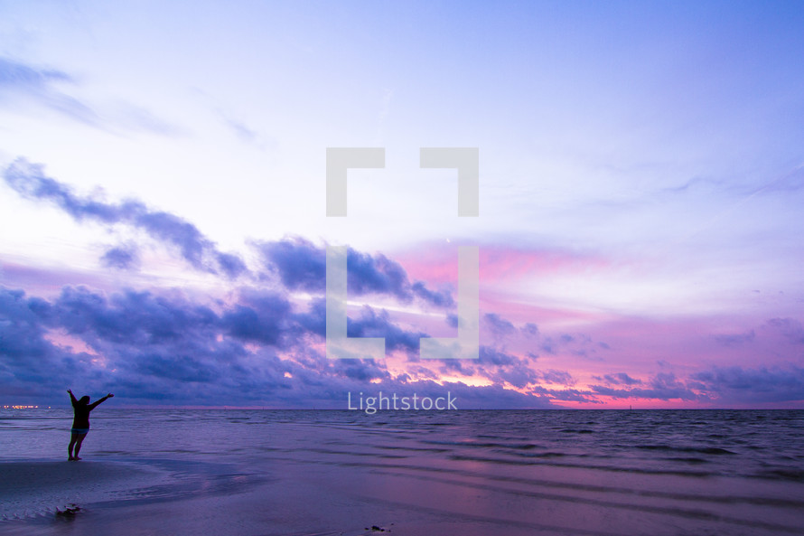 Standing on beach at sunset
