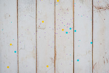 paint splatter on a white wood background