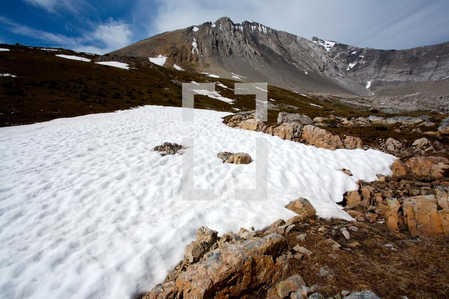 Snow ridge on mountainside,