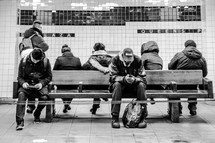 people waiting in a subway station