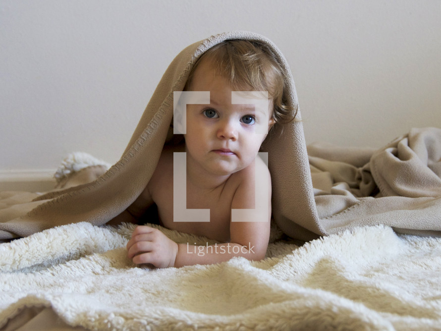 Cute baby under blanket