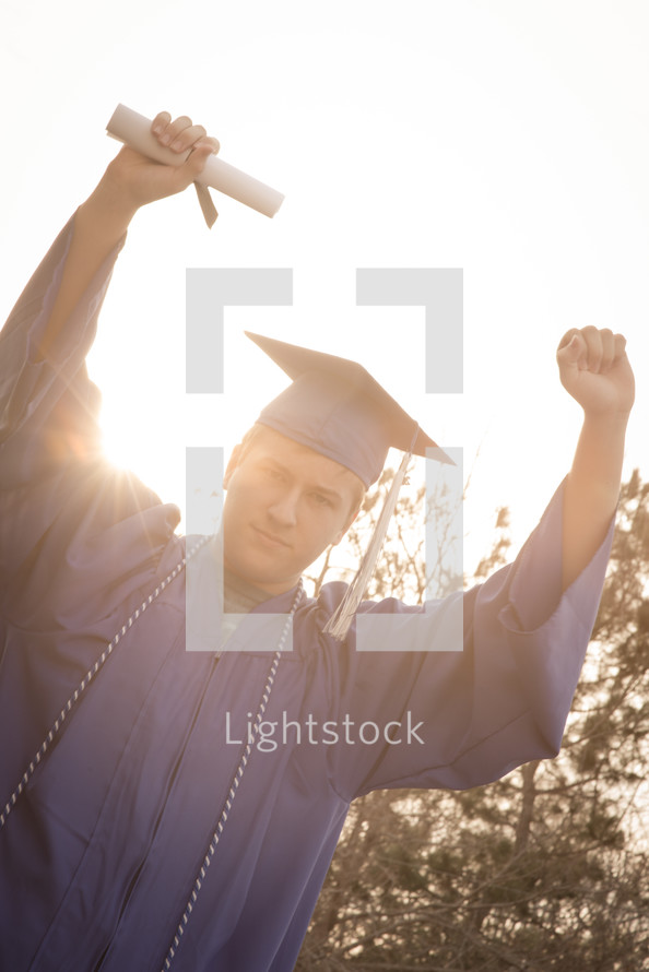 graduated holding up his diploma