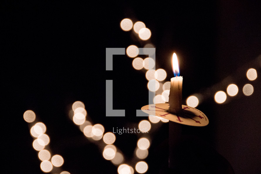 candlelight at a Christmas Eve worship service