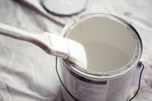 paint brush in a bucket