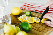 slicing lemons and limes in the kitchen