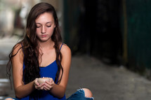 teen girl sitting holding a candle