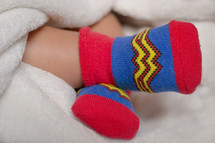 Wonder Woman socks on an infant