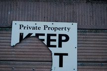 torn private property keep out sign