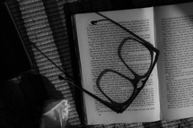 reading glasses on the pages of a book