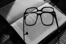 glasses on the pages of a book