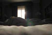 morning sunlight through a window into a bedroom