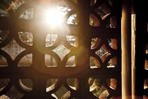 sunlight peeking through a lattice window