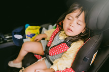 sleeping child in a carseat