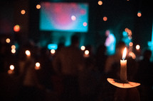 congregation holding candles at a Christmas Eve worship service