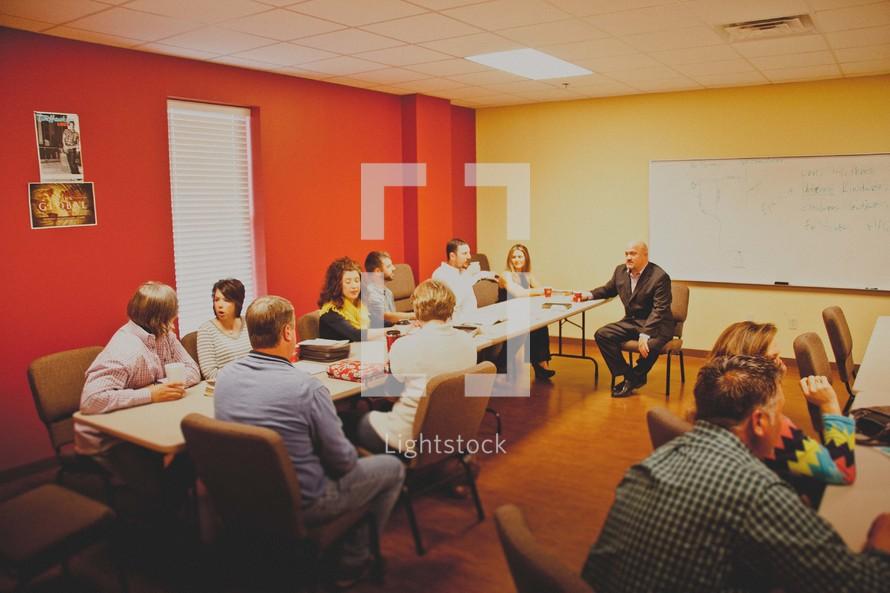 Sunday school, Bible study, sitting, people, man, woman, table, classroom