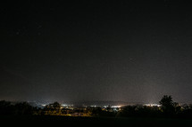 city lights from a hilltop at night