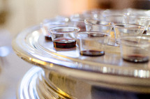 cups in a communion tray